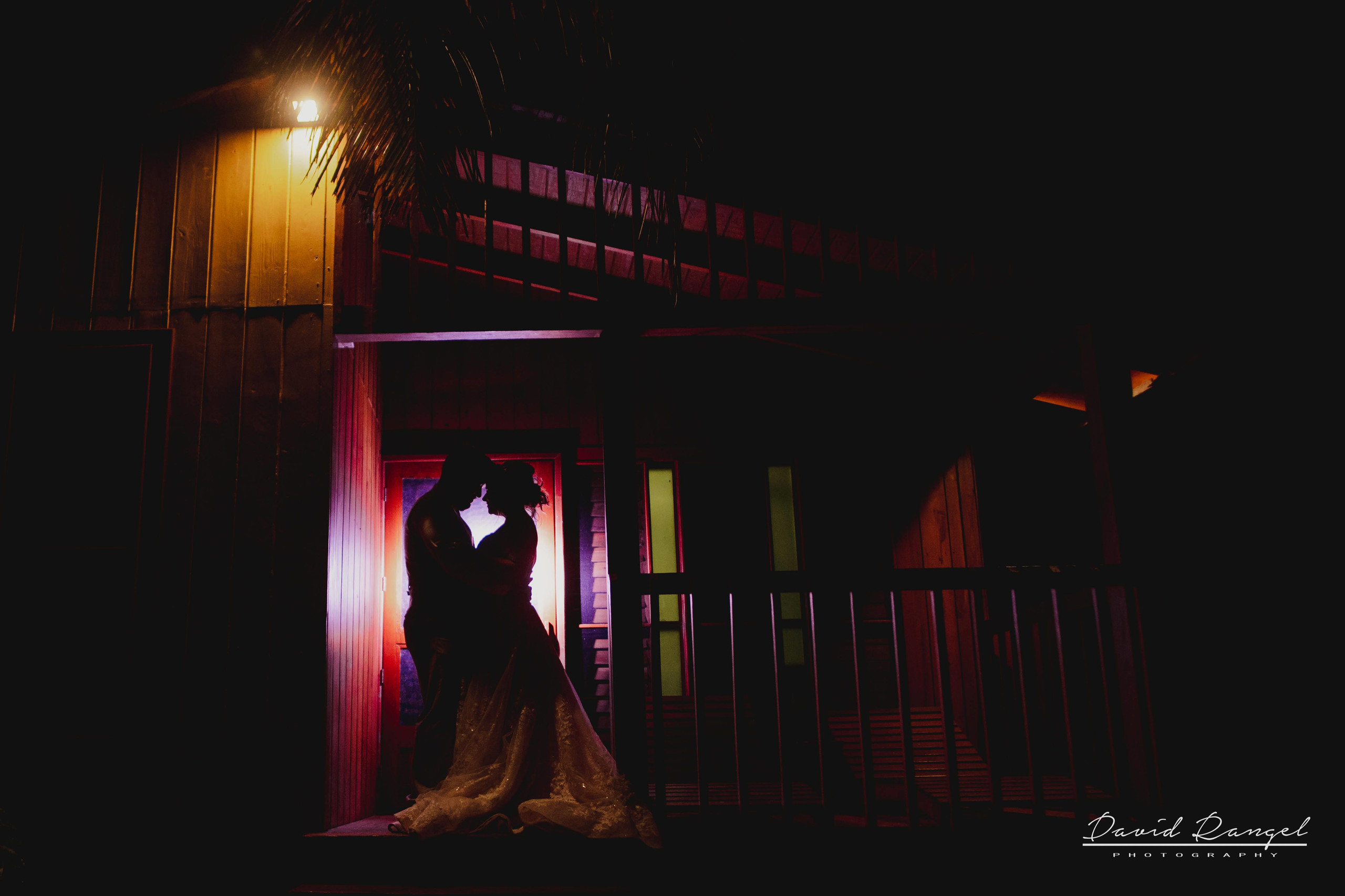 bride+groom+beach+session+happy+love+couple+celebration+wedding+photo+beach+caribean+sea+photographer+david+rangel+dress+suit+villa+chenera+main+entrance+reception+kiss+back+light