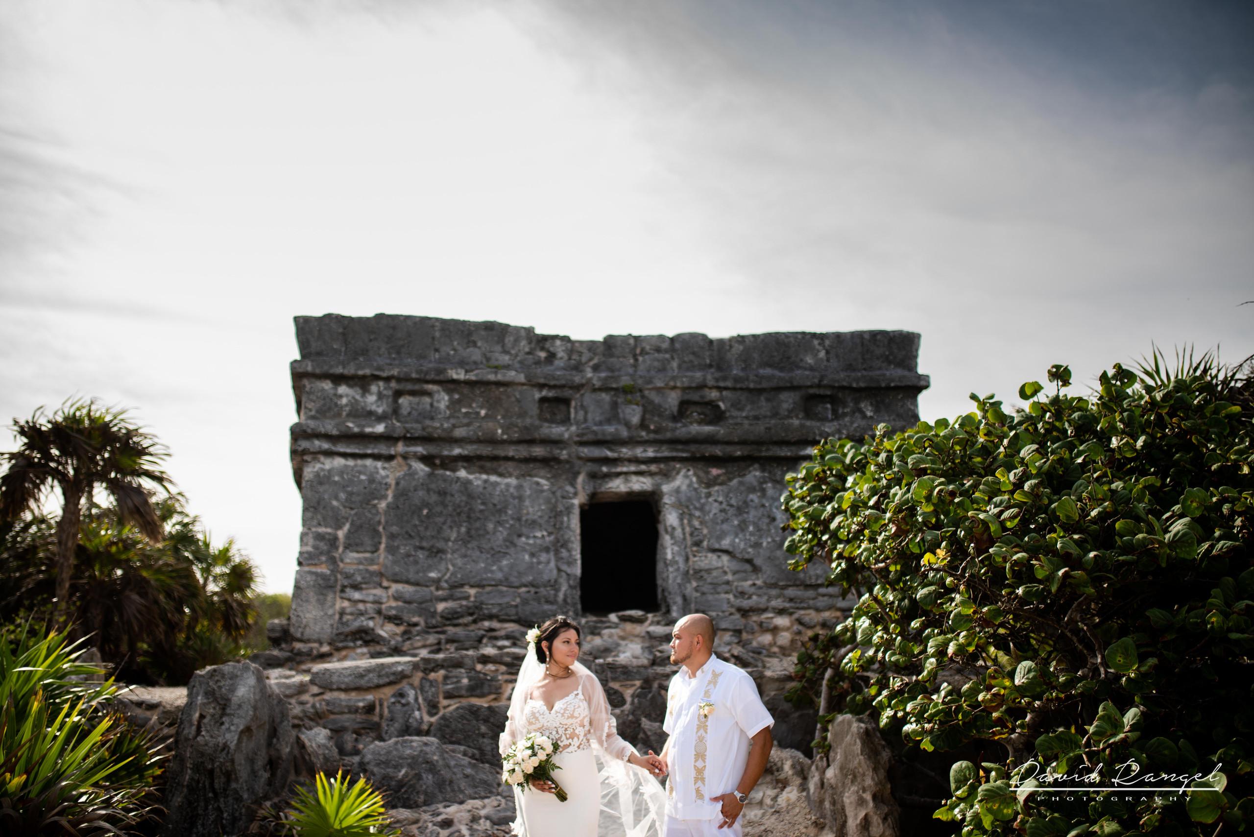 bride+groom+rocks+beach+riviera+maya+palm+trees+wedding+coverage+photo+bouquet+love+union+celebration+nature+caribean+sea+mayan+ruins