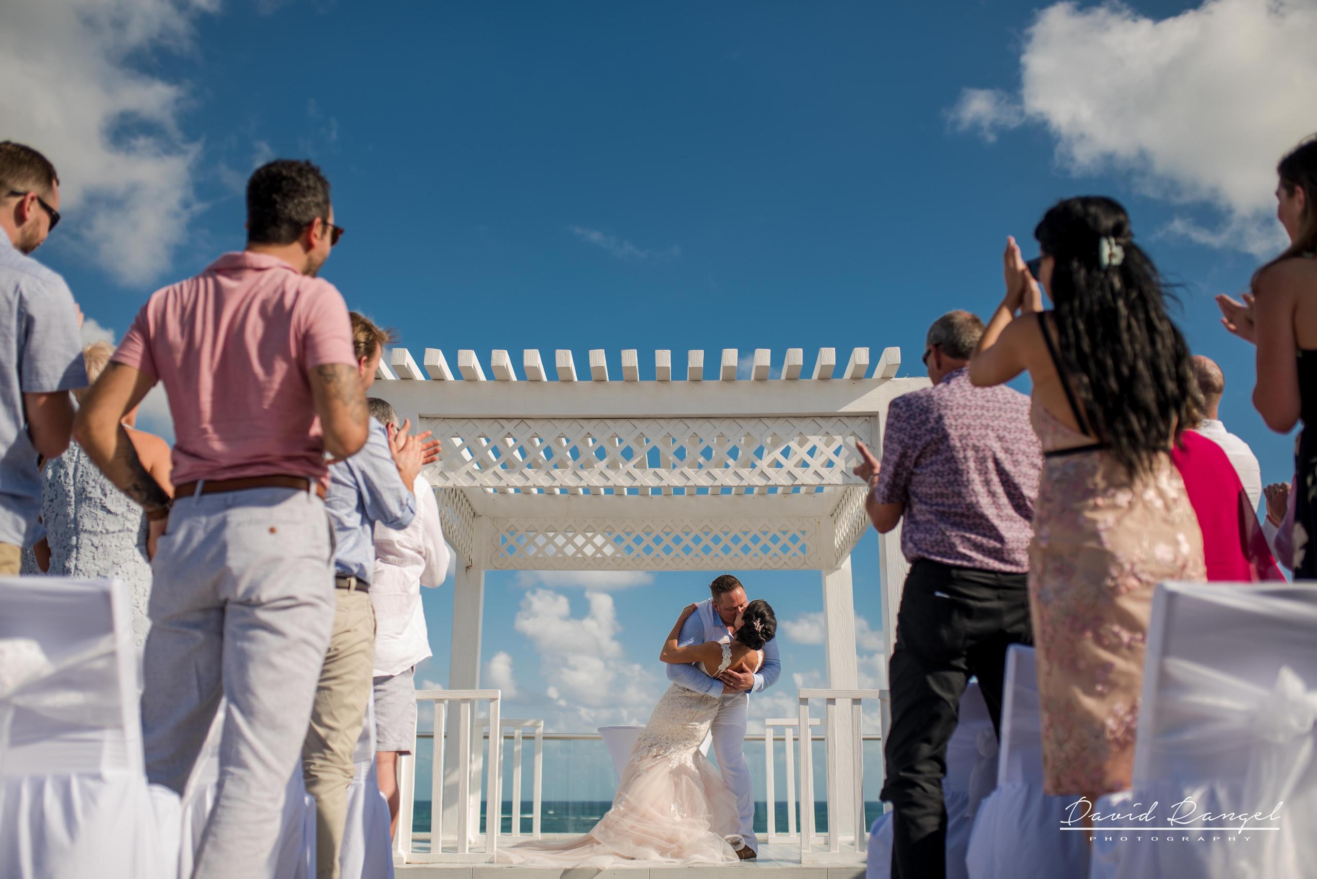 bride+groom+sky+deck+terrace+azul+beach+resort+photo+ceremony+gazebo+she+say+yes+kiss+married