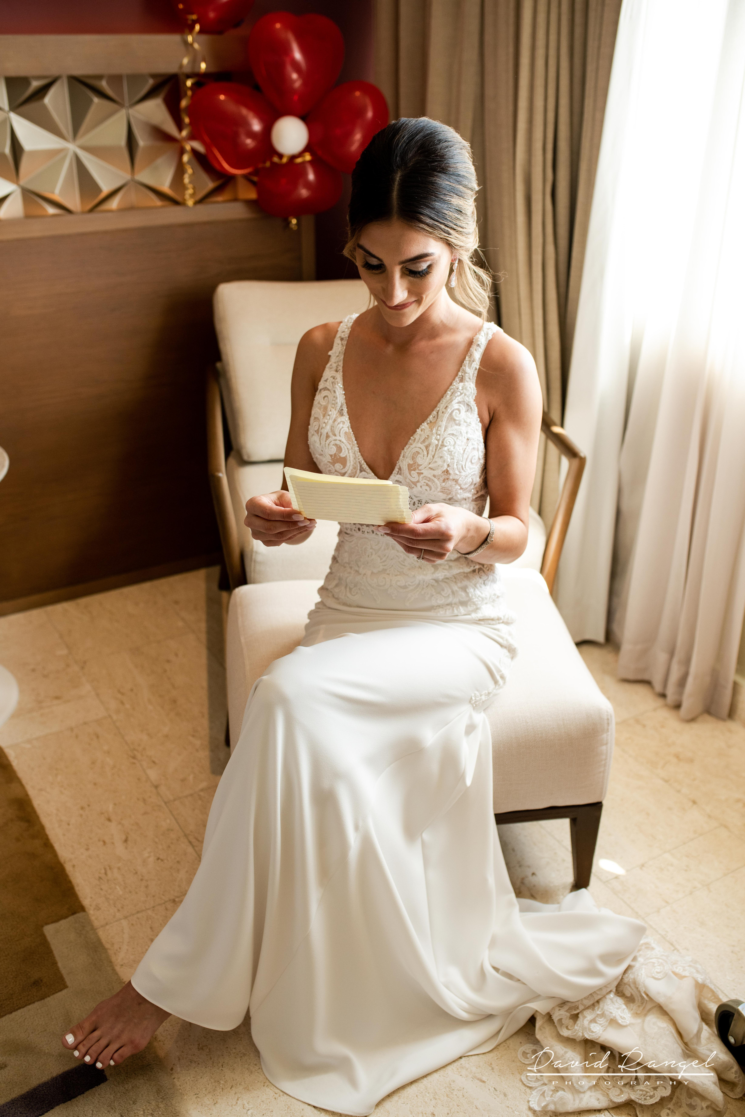 bride+getting+ready+reading+vows