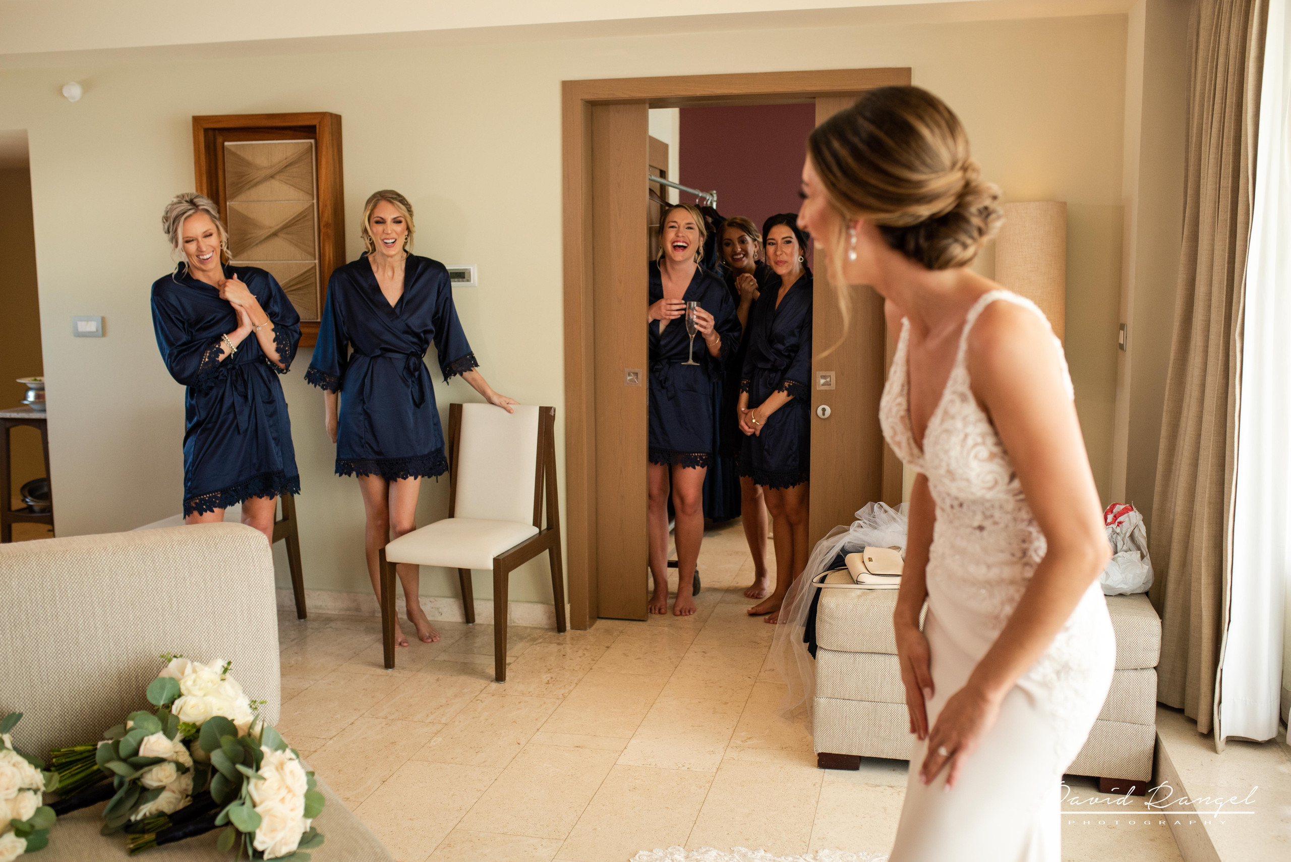 bride+getting+ready+dress+exited+bridesmaids