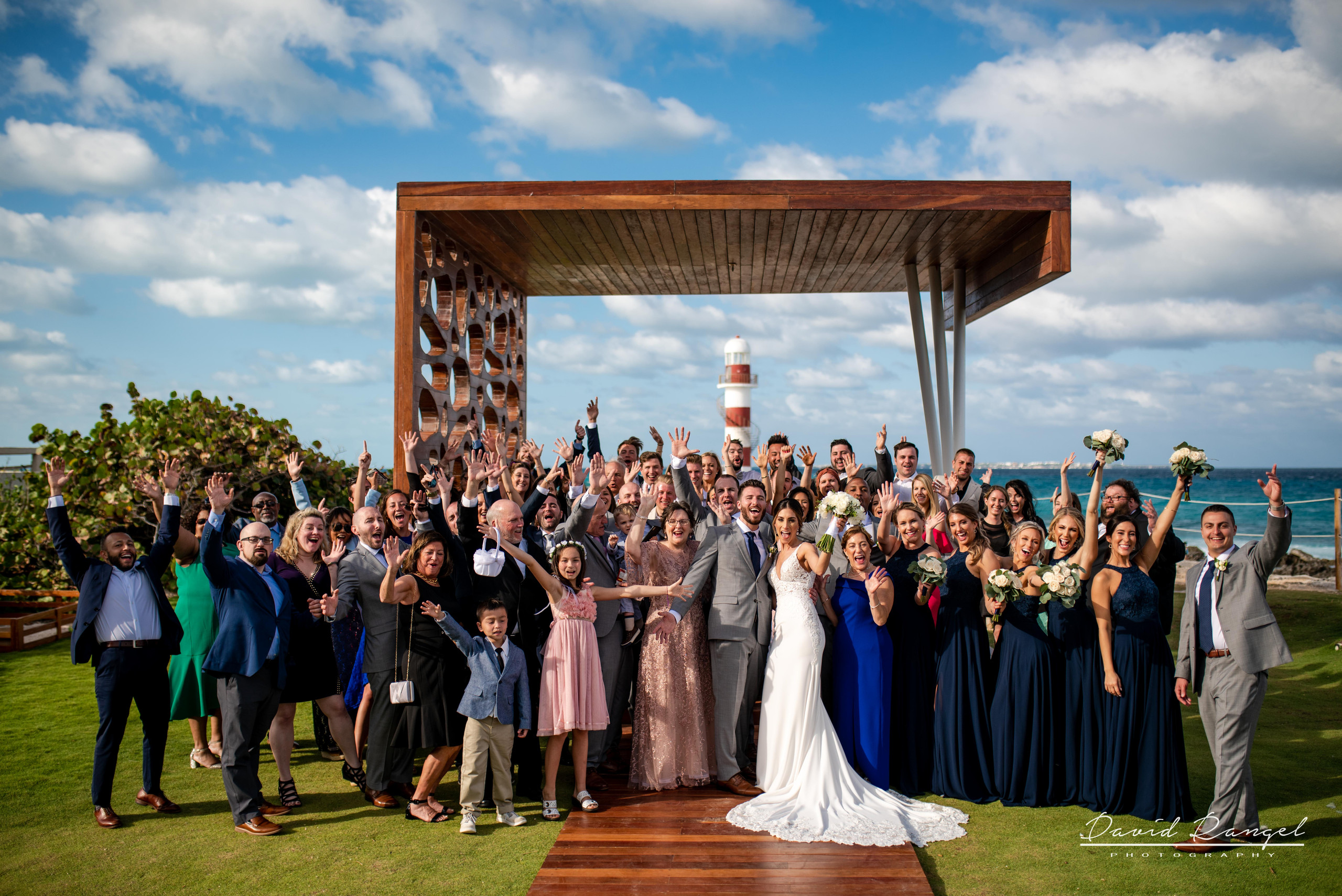 group+photo+entire+family+beach+lighthouse+wedding+ceremony