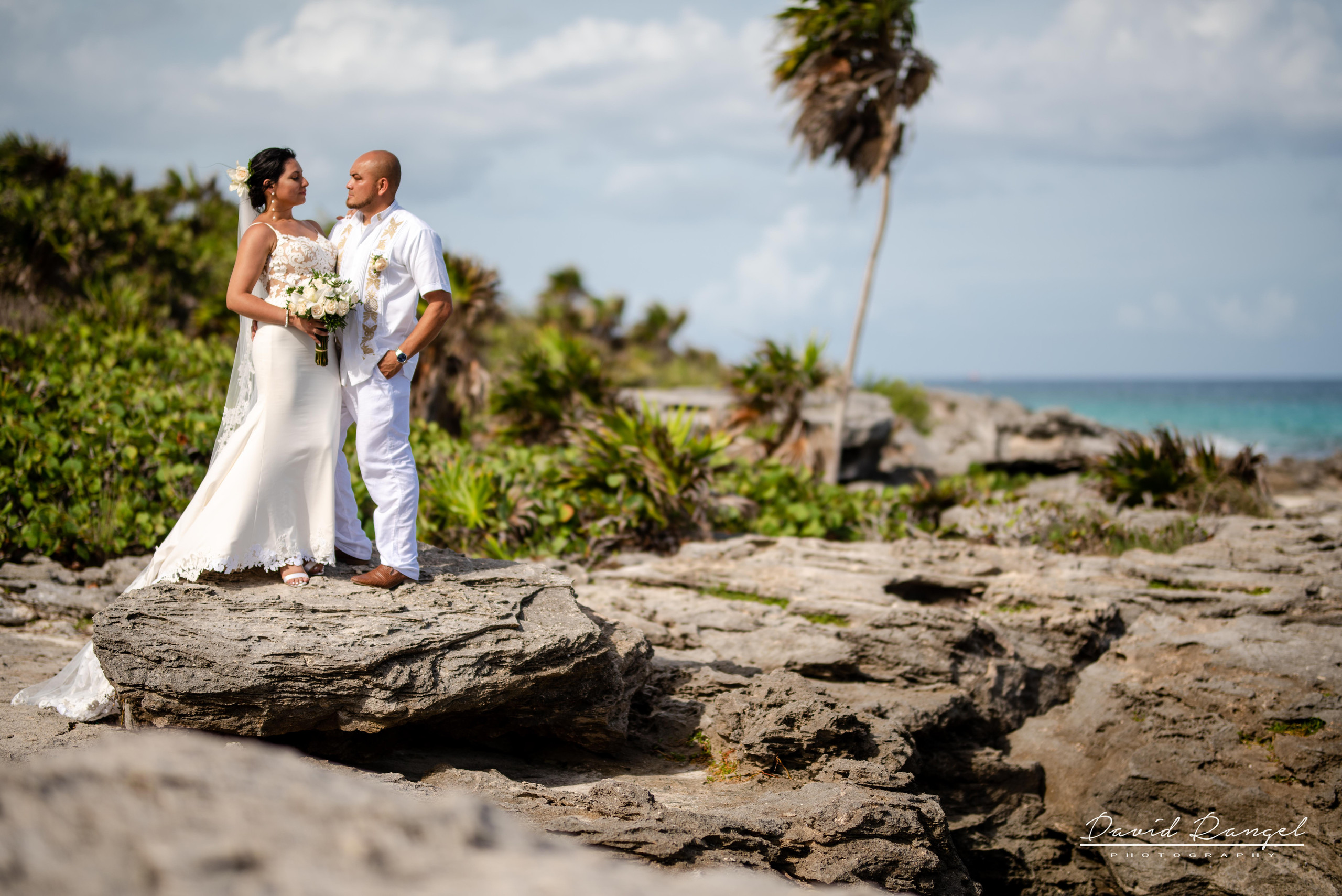bride+groom+rocks+beach+riviera+maya+palm+trees+wedding+coverage+photo+bouquet+love+union+celebration+nature+caribean+sea
