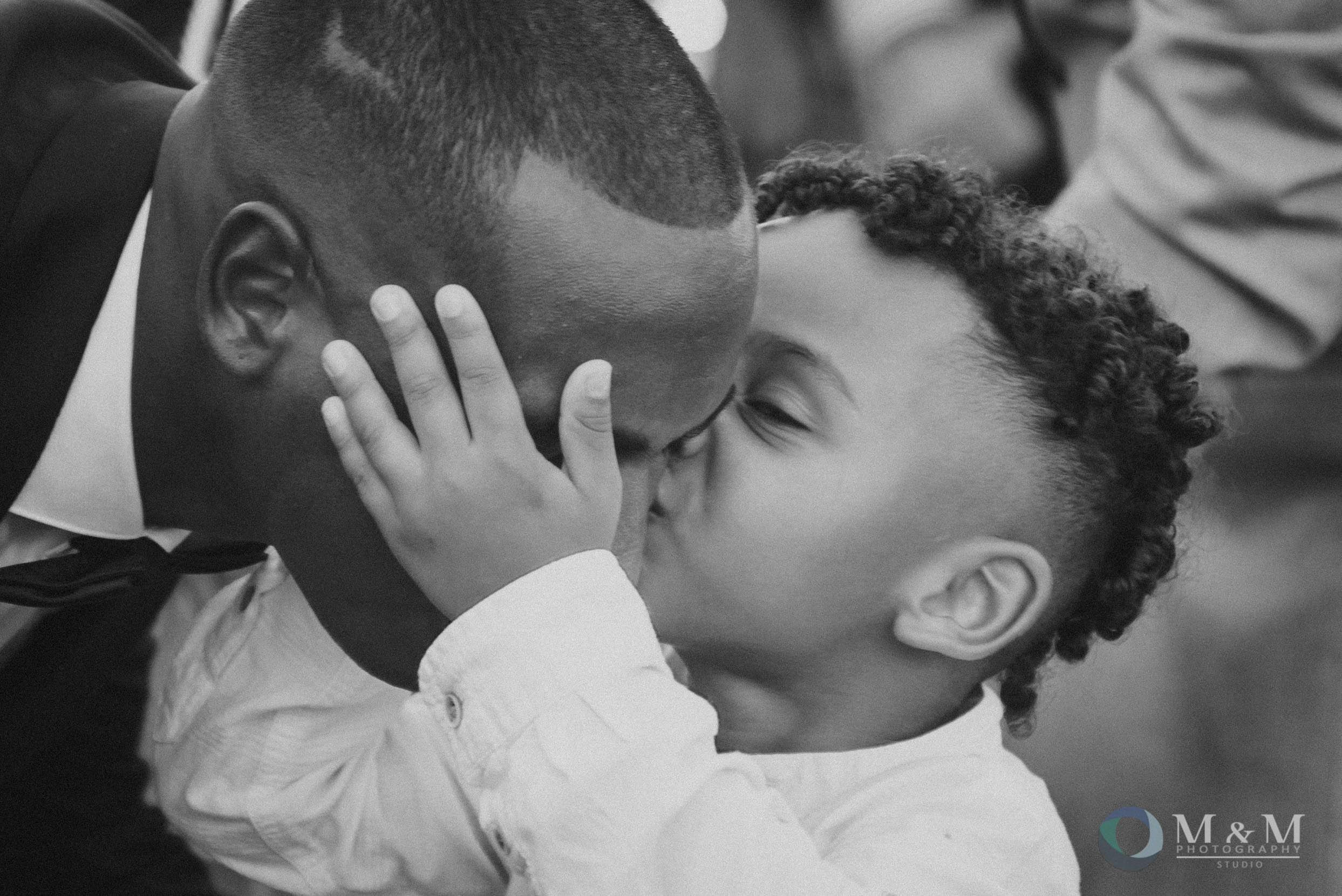 groom+son+kiss