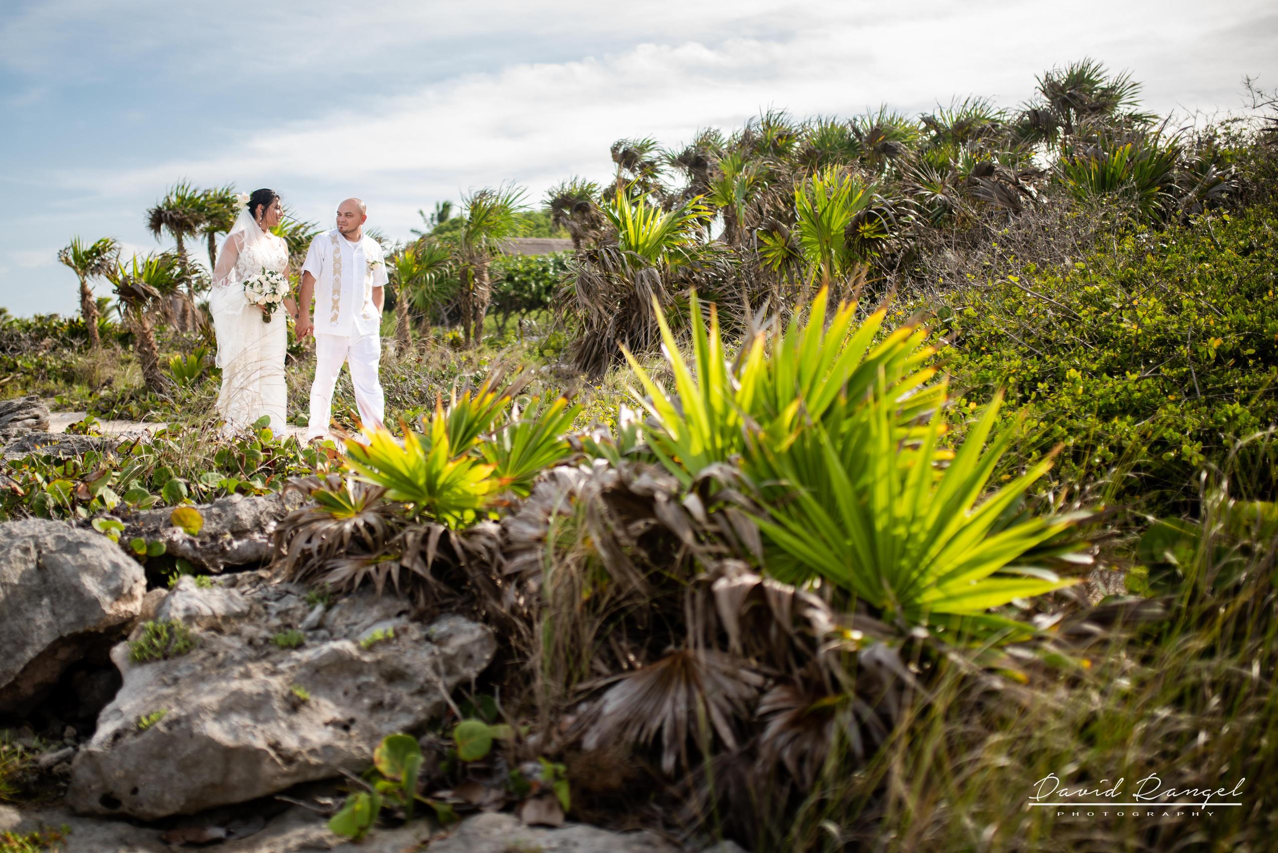 bride+groom+rocks+beach+riviera+maya+palm+trees+wedding+coverage+photo+bouquet+love+union+celebration+nature+caribean+sea+walk