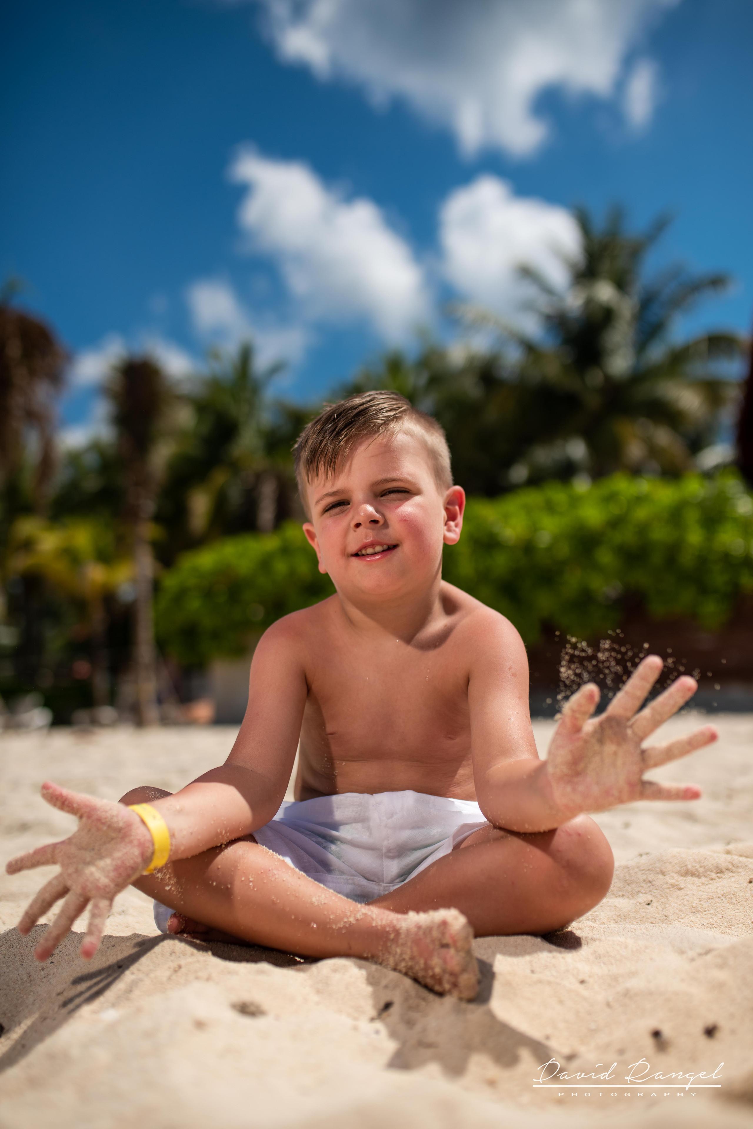 kid+boy+session+beach+cozumel+island+photo+destination+photographer+play+water+pier+paradise+happy