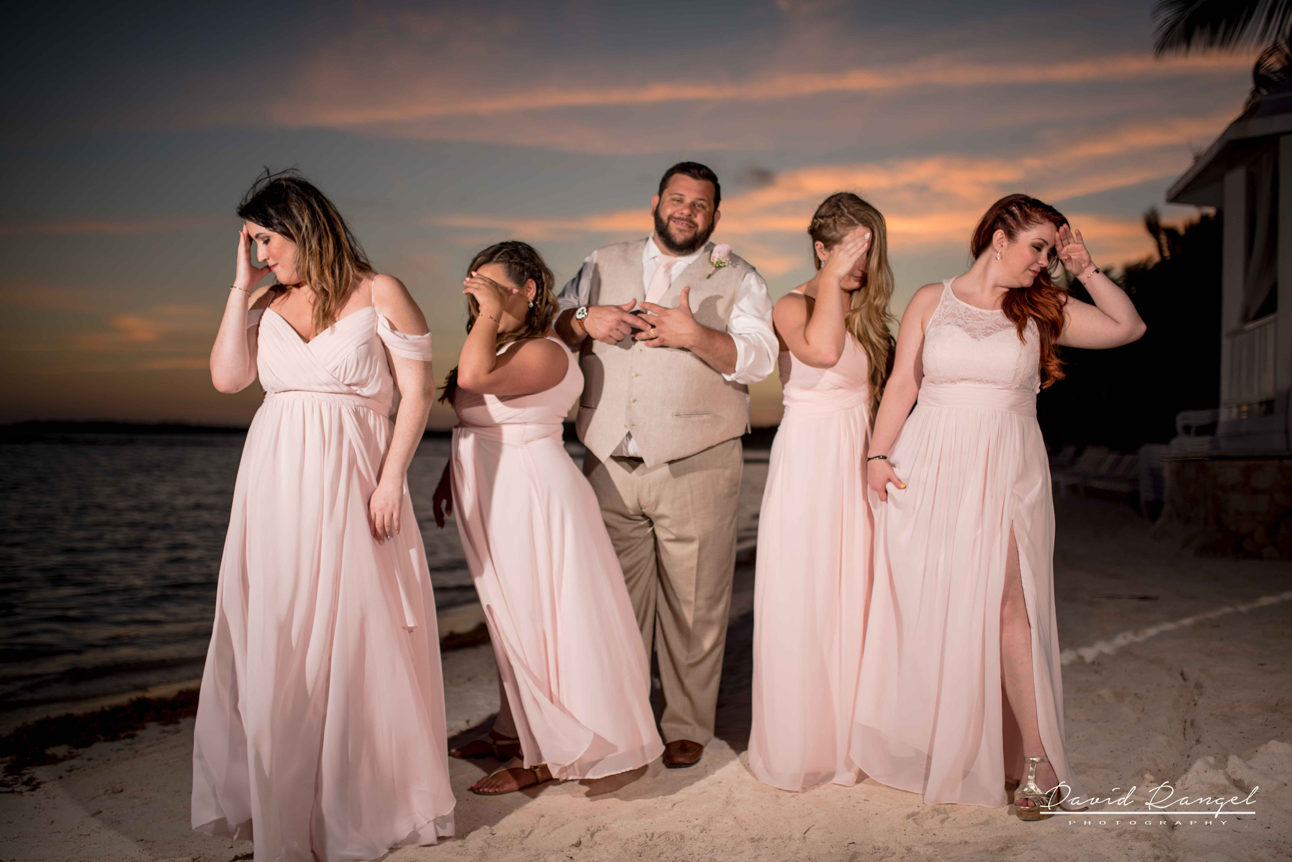 groom+bridesmaids+sunset+photo