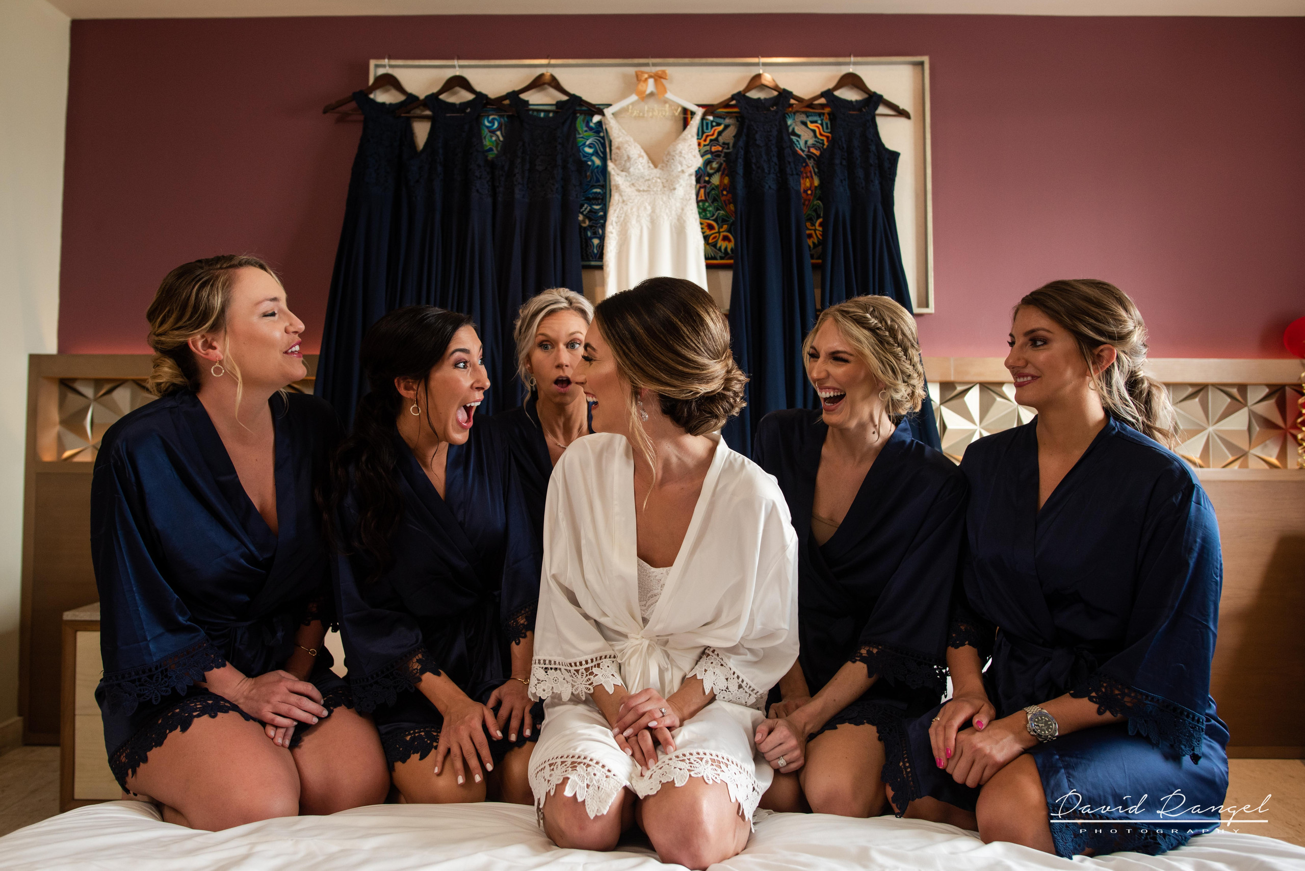 bride+getting+ready+celebration+bridesmaids