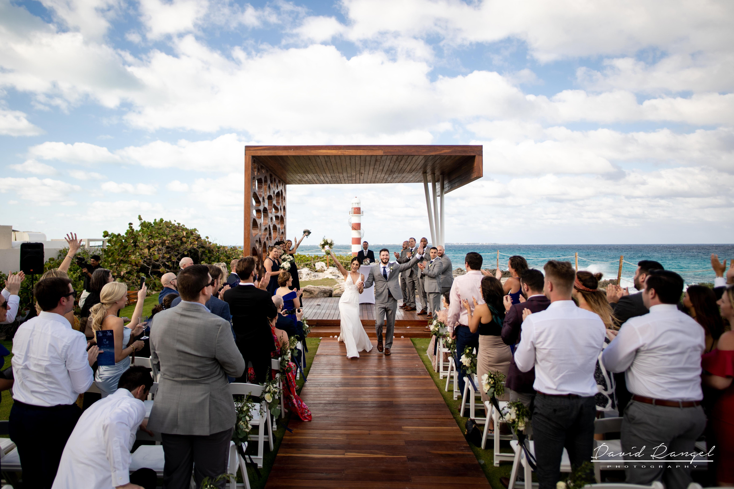 walk+aisle+bride+groom+ceremony+happy+lighthouse+gazebo+wedding+ceremony+photo