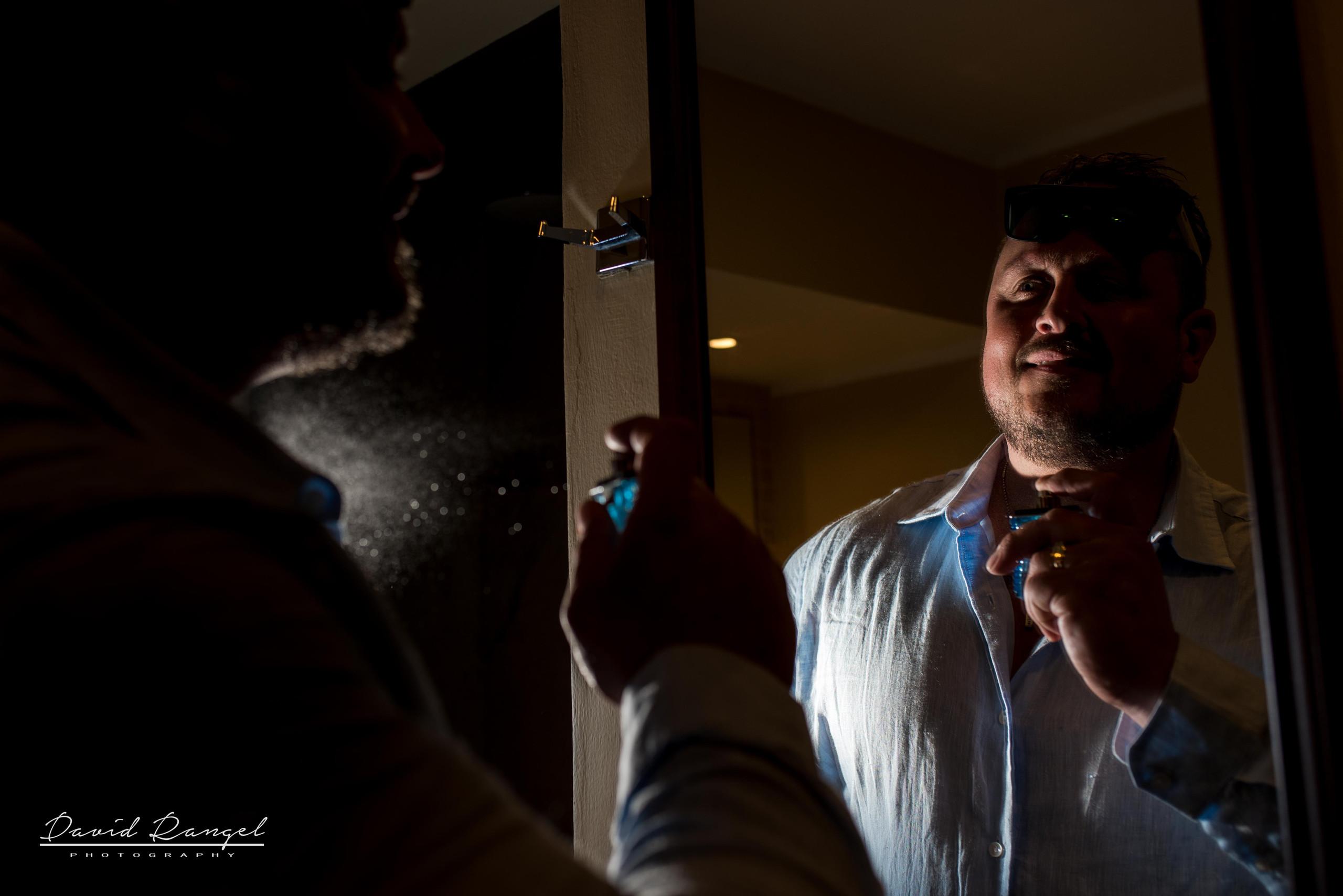 back+light+groom+getting+ready+mirror