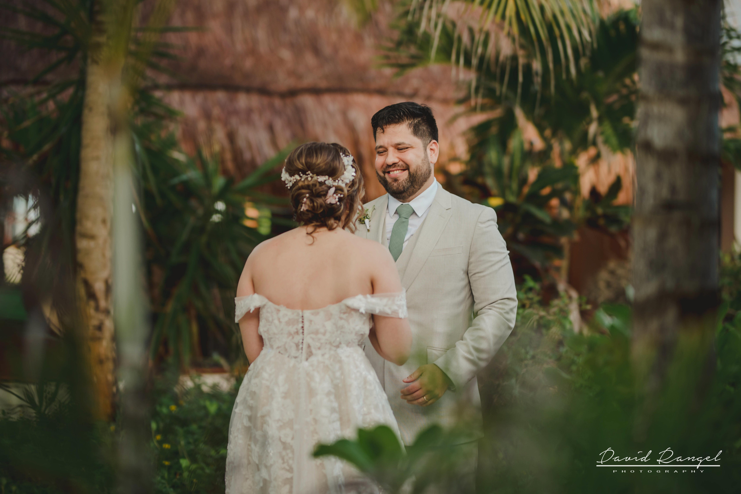 bride+candy+shot+beach+isla+blanca+villa+chenera+photo+costa+mujeres+first+look+groom+surprise+garden+wedding+dress+suit+tie