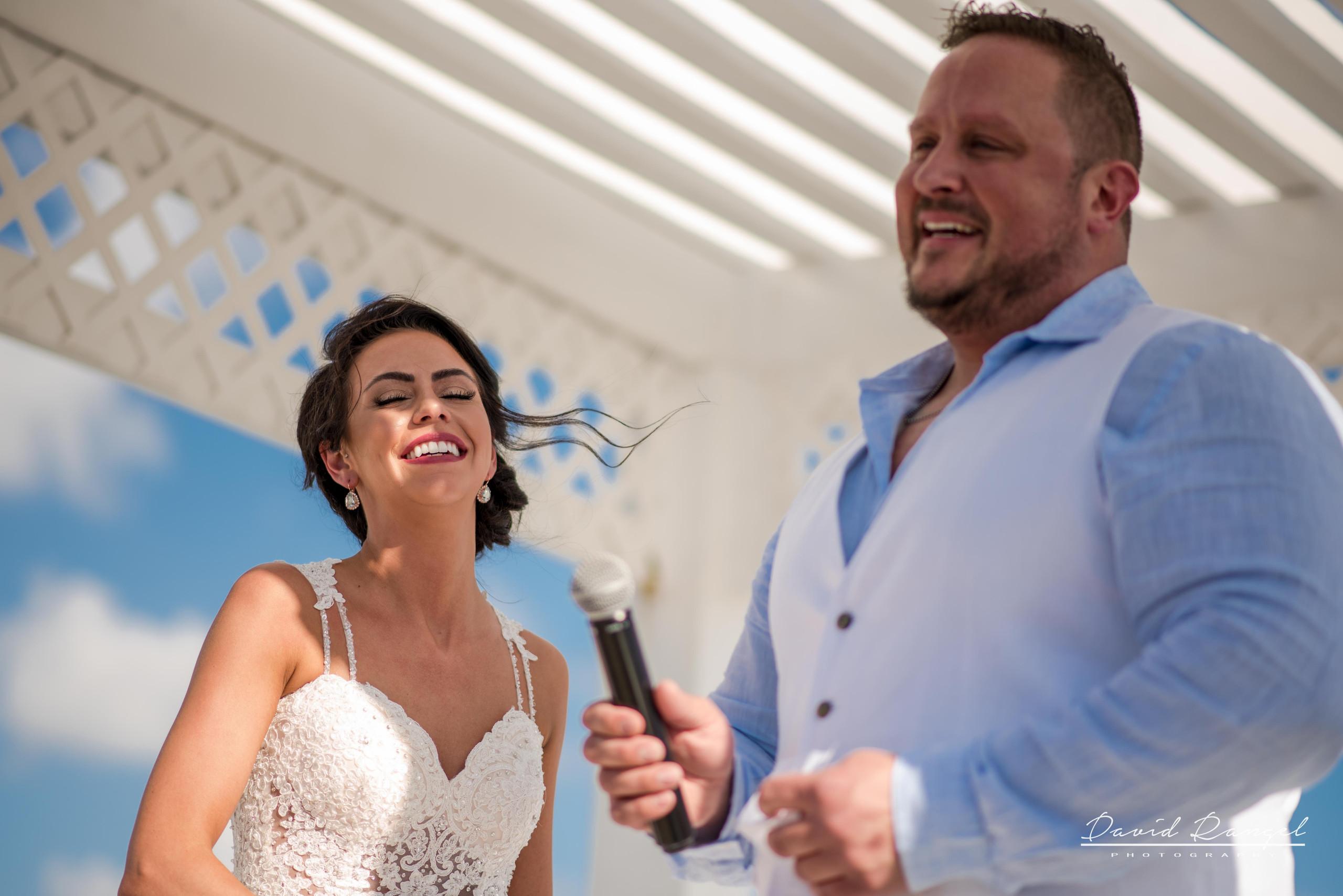 bride+groom+sky+deck+terrace+azul+beach+resort+photo+ceremony+gazebo+laughing