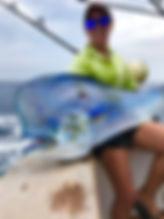 Laura MacLucas of Nambas Fishing charters with a Mahi Mahi