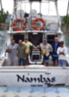 Customers on the deck of the fishing boat Nambas
