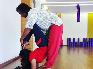 Scorpion posture by student in T.T.C Cla