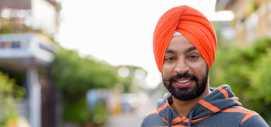 Portrait of young handsome Indian Sikh m