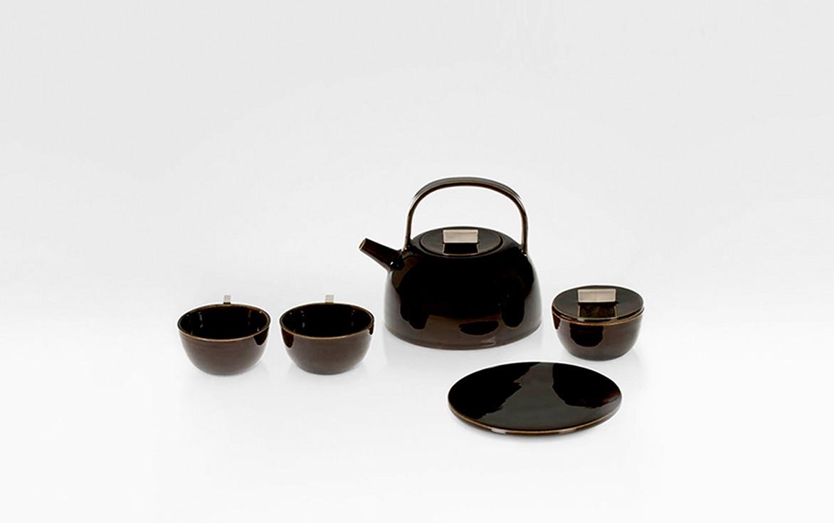 Dark brown enameled porcelain tea set with sterling silver details