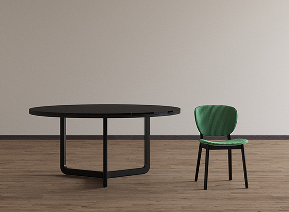 Round black glass top dining table with black solid oak structure. Ribbed velvetupholstered dining chair with dark oak structure