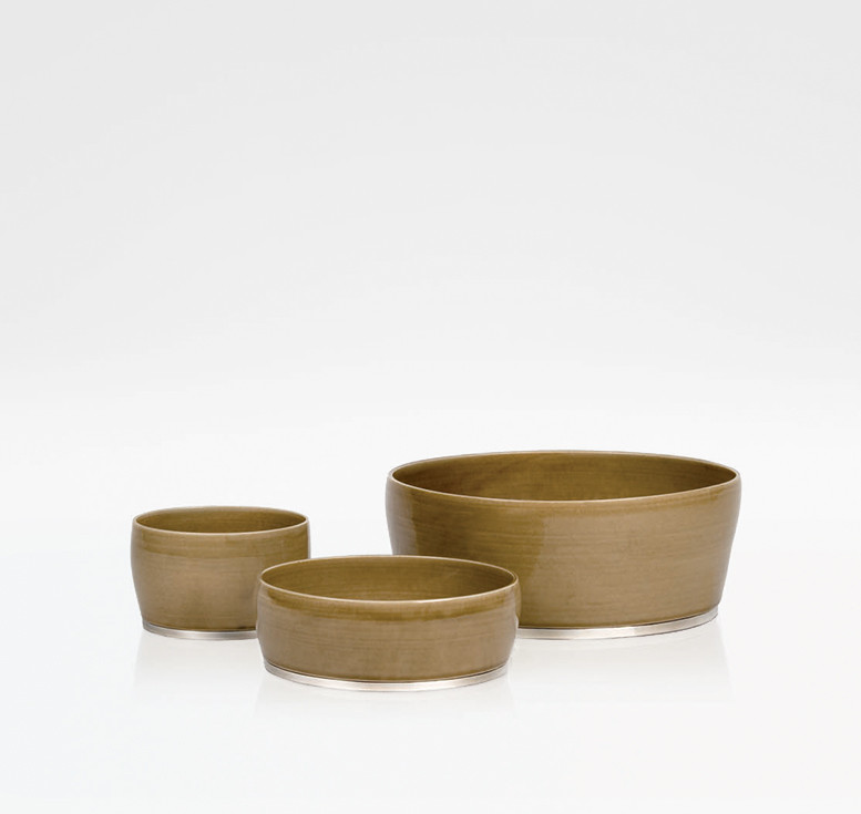 Brown stoneware bowls with sterling silver bottom rim