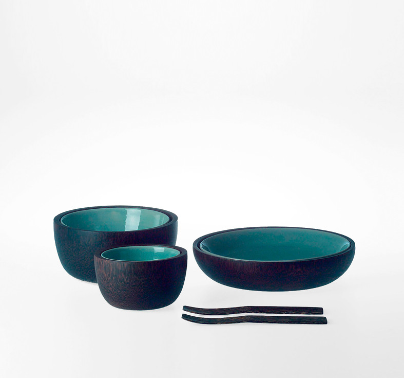 Blue-green painted stoneware bowls with coconut wood coating. Coconut wood cutlery