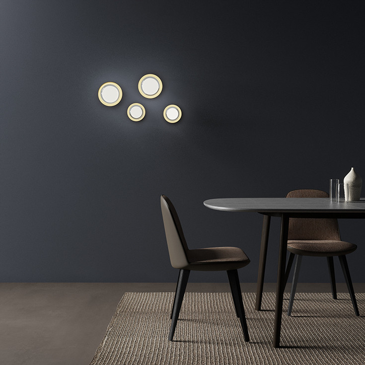 Solid dark brown oak dining table with oval Azul Makauba stone top. Double wall glass and brass screen diffusers wall lamps. Fabric and leather upholstered dining armchair with black oak ash structure