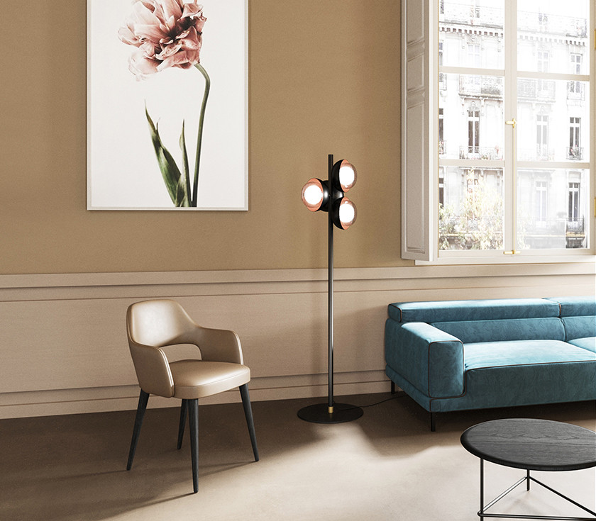 Leather upholstered dining armchair with dark oak conical legs.Neo-vintage metal floor lamp with glass and copper screen diffusers. Adjustable backrest velvet upholstered sofa. Dark oak lacquered veneertop with black powder coated steel structure coffee table
