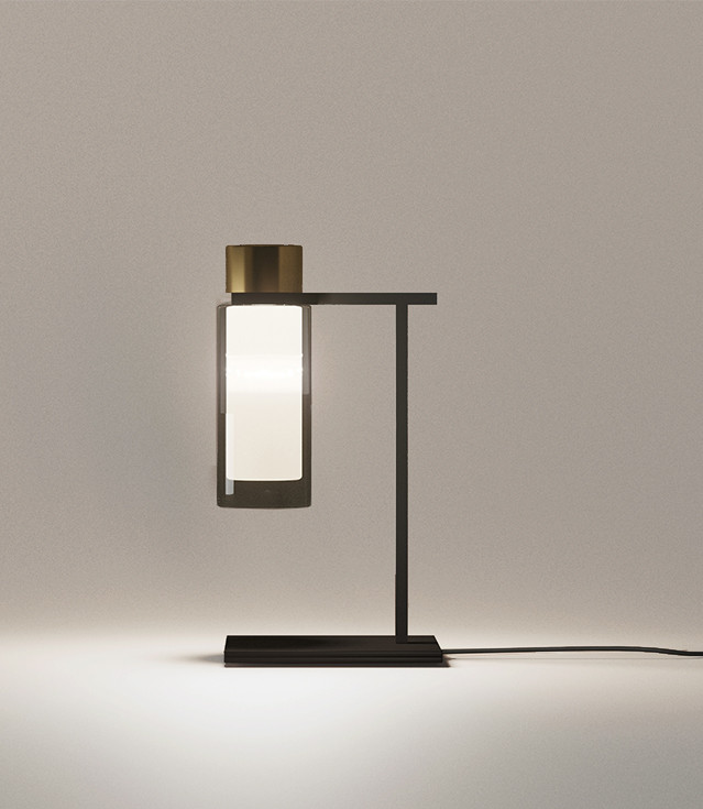 Smoked double wall glass table lamp with brushed brass details and steel structure