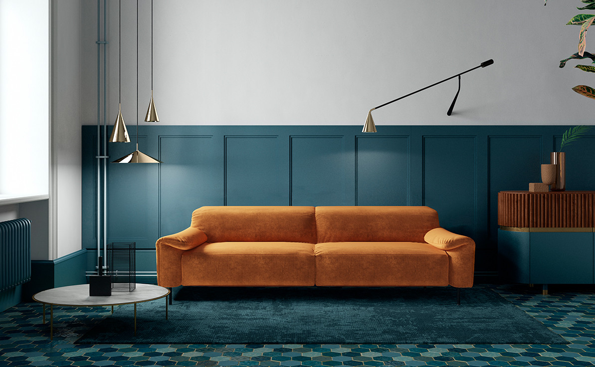 Orange velvetupholstered functional sofa. Adjustable black powder coated steel wall lamp with polished brass reflector. Polished brass pendant lamps. Gray stoneware top coffee table with bronzed metal base