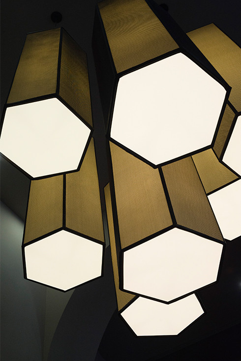 Oversized hexagonal tubes chandelier made in black net and white canvas shades