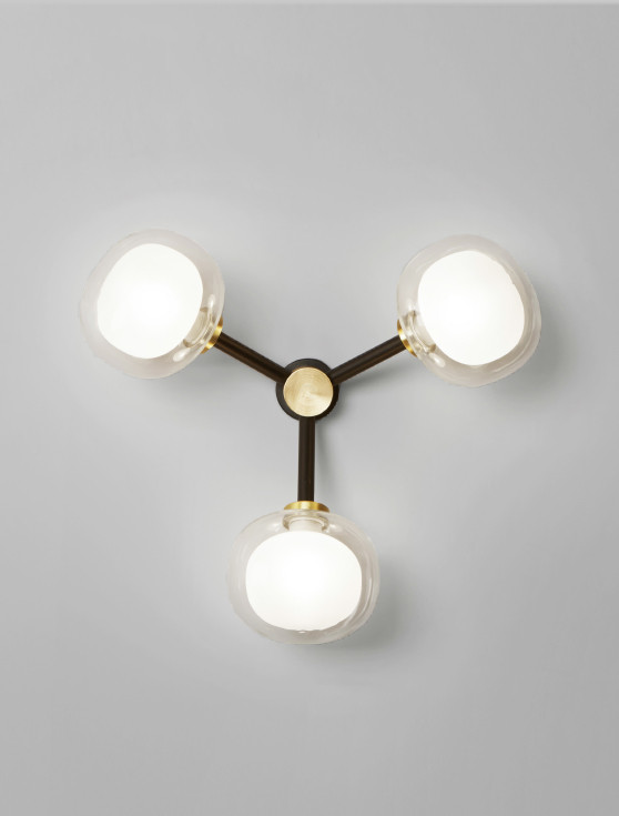 Sphere shaped double wall glass diffusers wall lamp with black powder coated steel structure and brass details