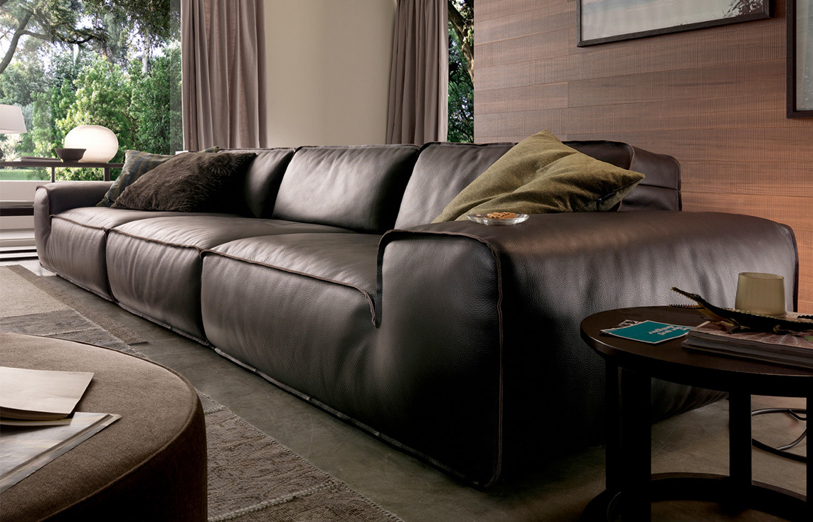 Full grain thick leather upholstered sofa. Dark brown lacquered MDF and solid wood side table