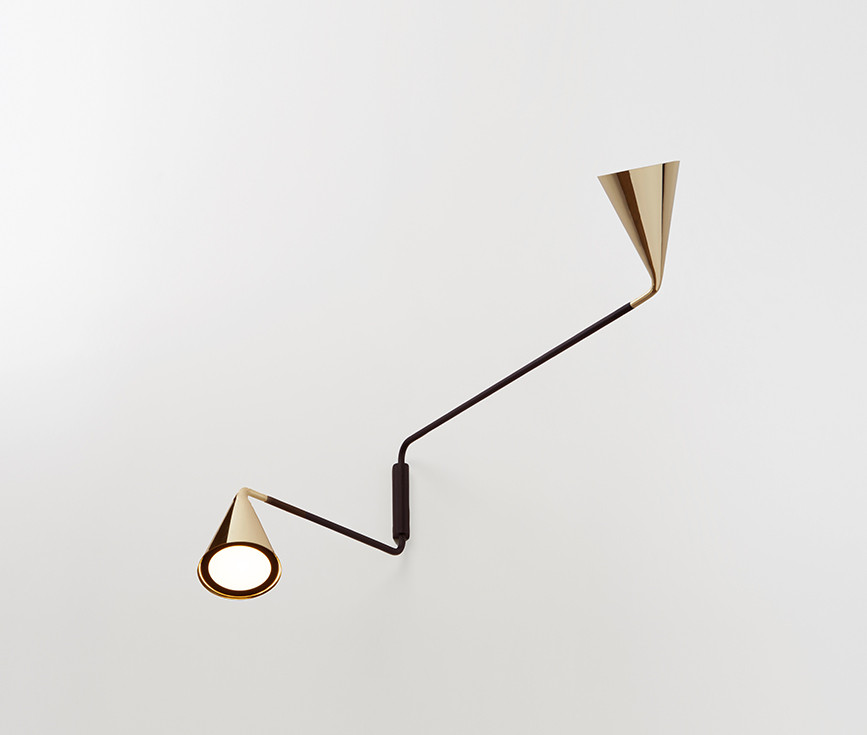 Adjustable black powder coated steel wall lamps with polished brass reflectors