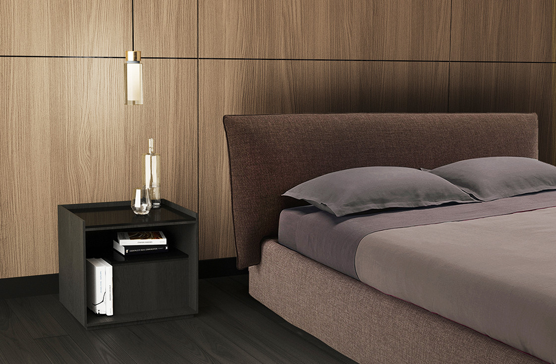 Fabric upholstered bed with soft head board embedded in the frame. Dark oak nightstand with black glass top. double wall glass pendant lamp with brushed brass details and steel structure
