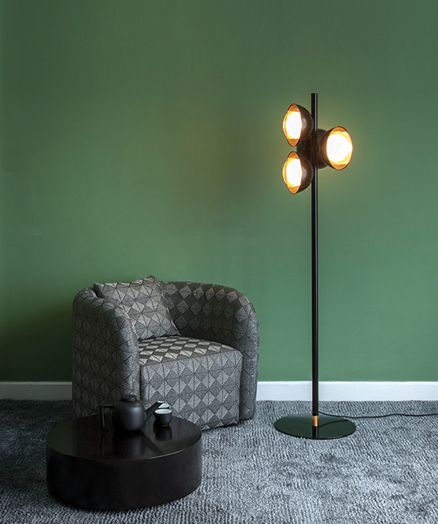 Silver diamond fabric upholstered armchair. Neo-vintage metal floor lamp with glass and copper screen diffusers