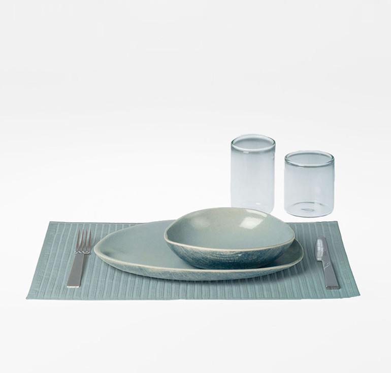 Shell shaped stoneware tableware. Silver plated cutlery. Mouth blown raw glads Tumblers