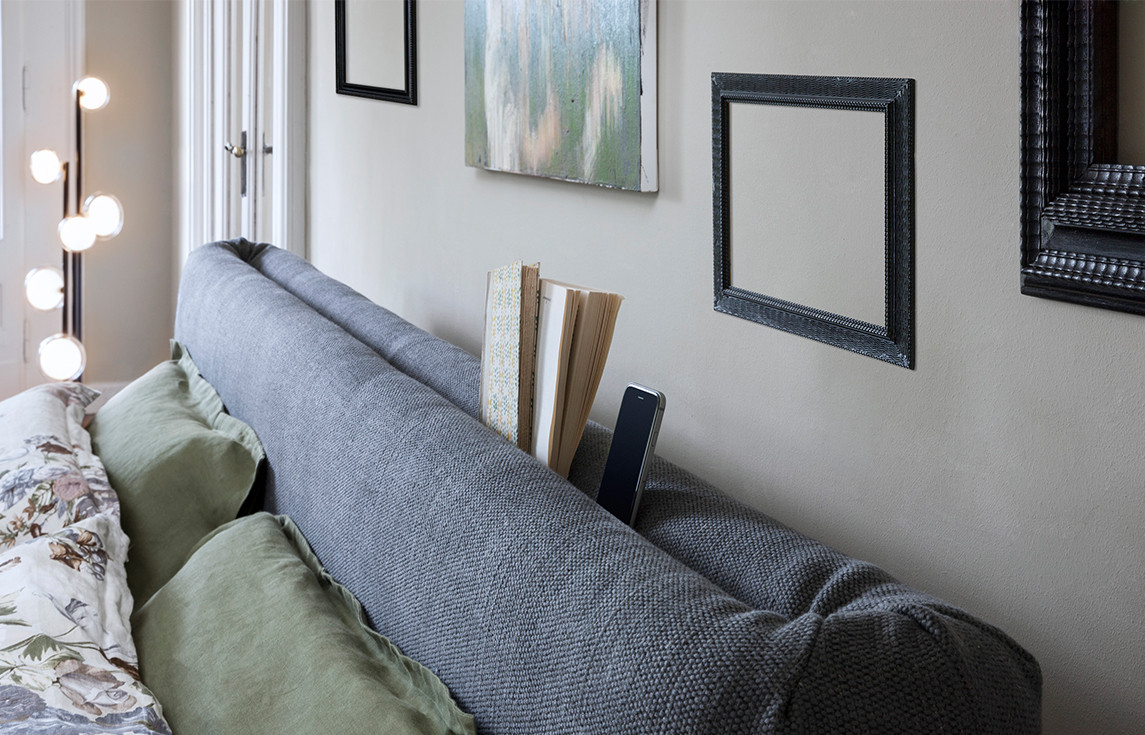 Fabric upholstered bed with functional headboard