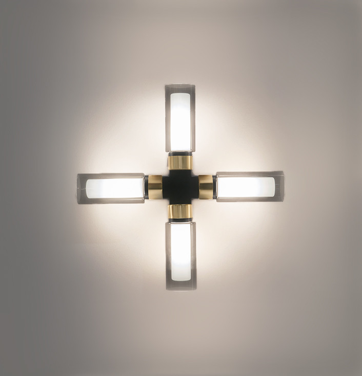 Smoked double wall glass cross shaped wall lamp with brushed brass details and steel structure