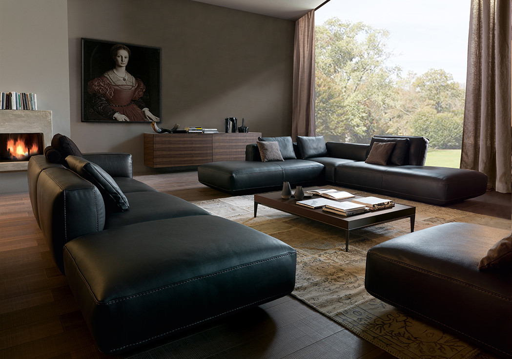 Full grain leather sectional sofa with adjustable backrests. Lacquered MDF top coffee table with bronzed steel base