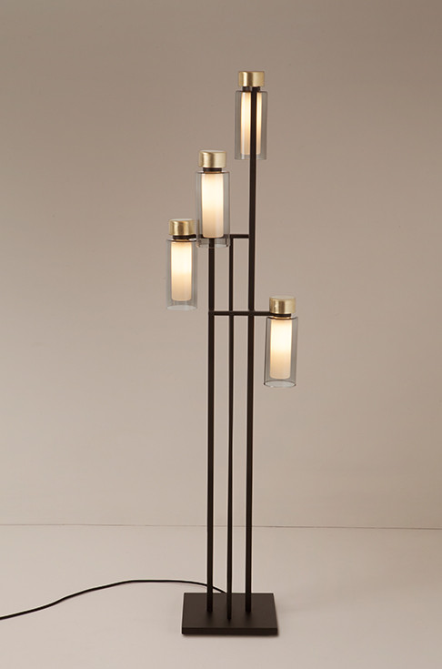 Smoked double wall glass floor lamp with brushed brass details and steel structure