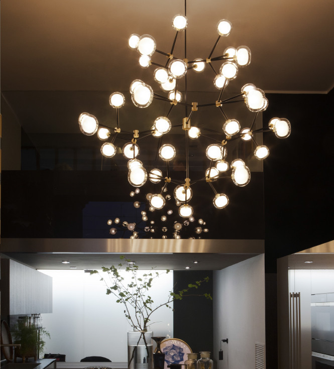Sphere shaped double wall glass diffusers monumental chandelier with black powder coated steel structure and brass details