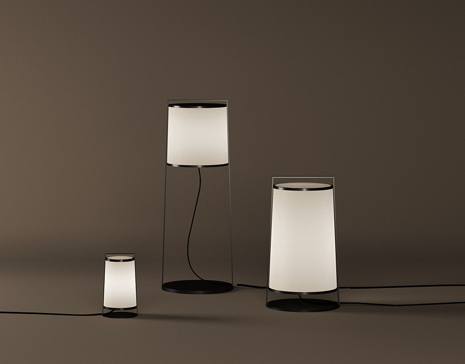 Lantern shaped black painted steel floor and table lamps with ivory color fabric lampshade