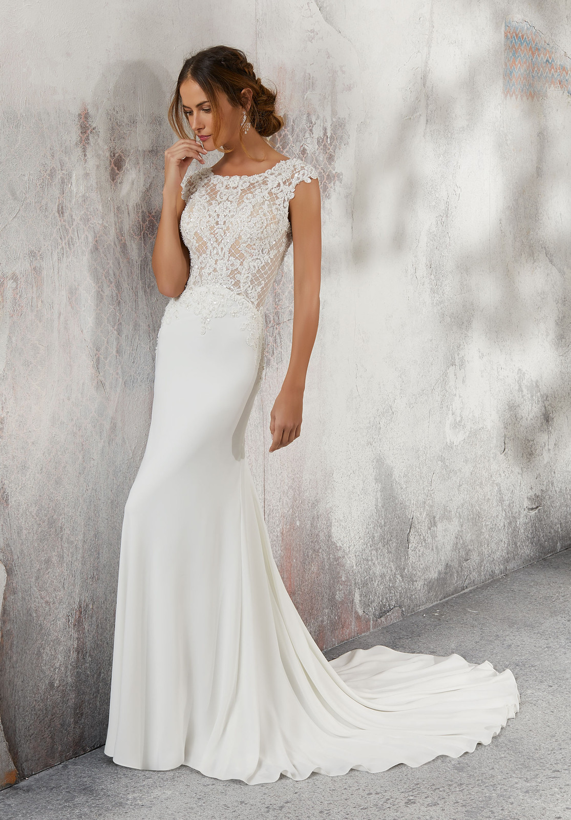 fa3c5501 Lesley Form Fitting Crepe Bridal Gown Featuring an Intricately Beaded  Bodice Accented in Alençon Lace Appliqués and Cross-Stitch Embroidery.