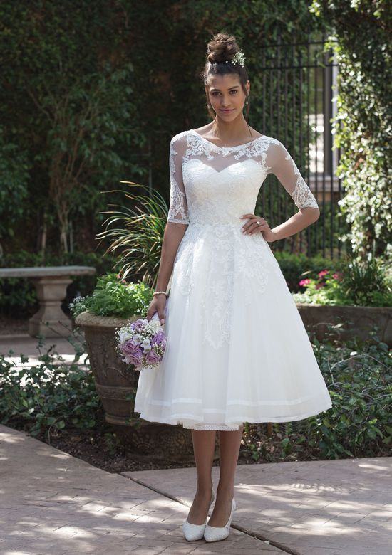 3d57eed40 Embroidered lace covers the sweetheart bodice down the full skirt. Soft  trim lace accents the hem of the wedding dress. The detachable  three-quarter ...