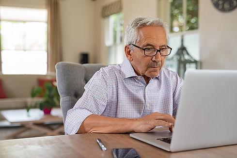 bigstock-Senior-man-working-with-laptop-