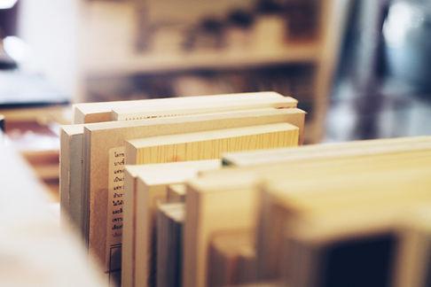Books sit on a shelf.