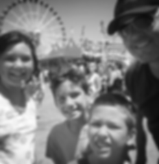 Founder, Jeffrey Smith and his children at The OC Fair