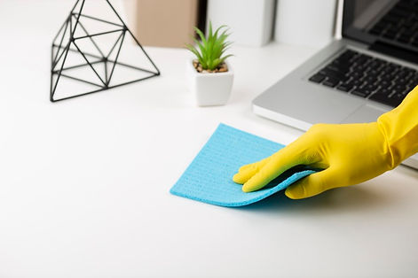 hand-cleaning-office-desk_23-2148333870.