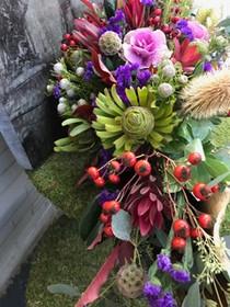Flower arrangement in a palm leaf