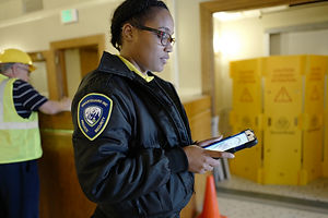 SMARTGUARD INC. on-site security officer with GPS enabled Smartphone and Tablet
