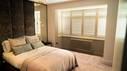 Bob bay window shutters with midrail divide